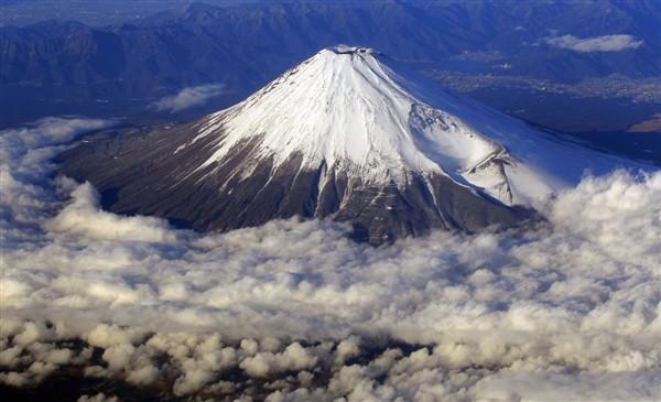 Fuji Yama in Japan is an example of Volcanic mountain.